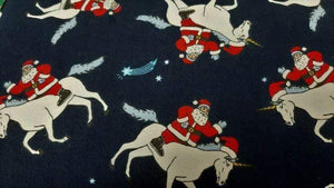 Flannelette Fabric In Navy Santa Riding Unicorns - Christina's Fabrics Online Superstore