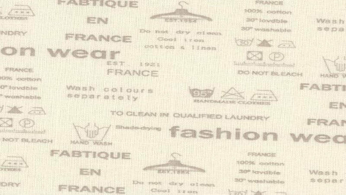 Cotton Canvas Fabric In Cream Laundry Writing - Christina's Fabrics Online Superstore