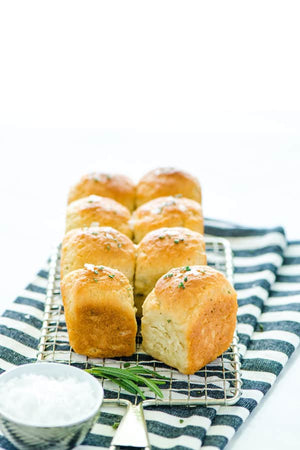 Soft gluten free rosemary rolls are flavored with fresh rosemary