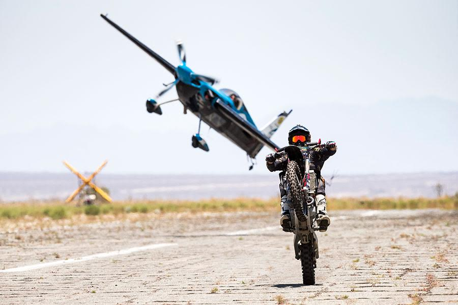 Airplane flying over dirt bike