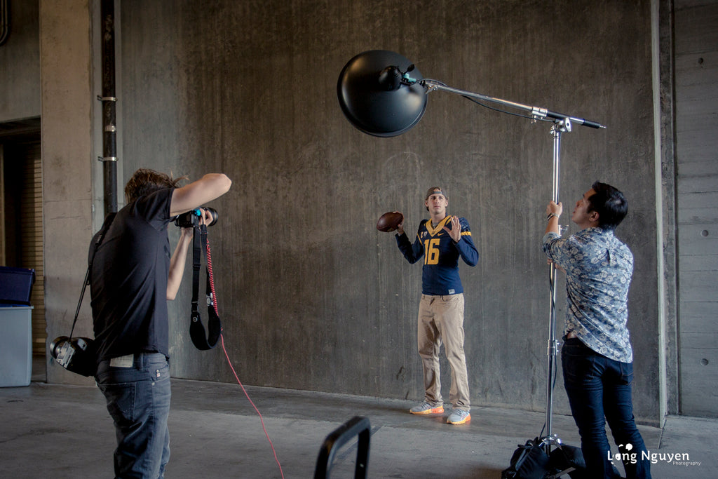 Dustin Snipes photographing Jared Goff