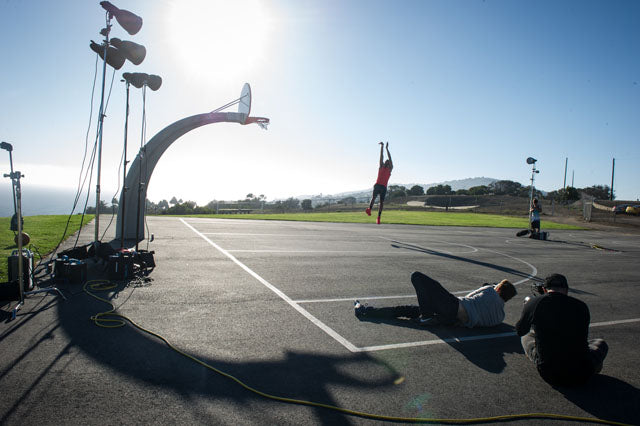Dustin Snipes photographs Anthony Davis dunking the sun