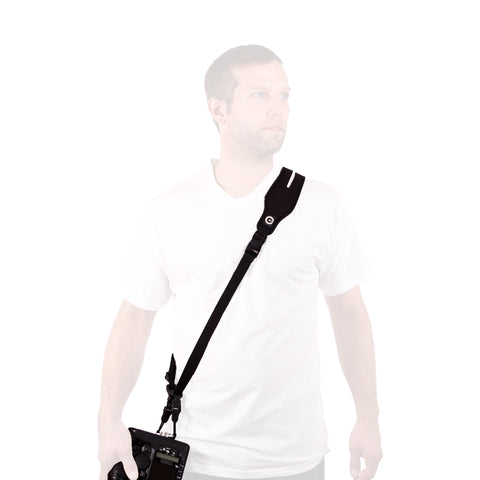 Man wearing Glide One Strap System with DSLR camera