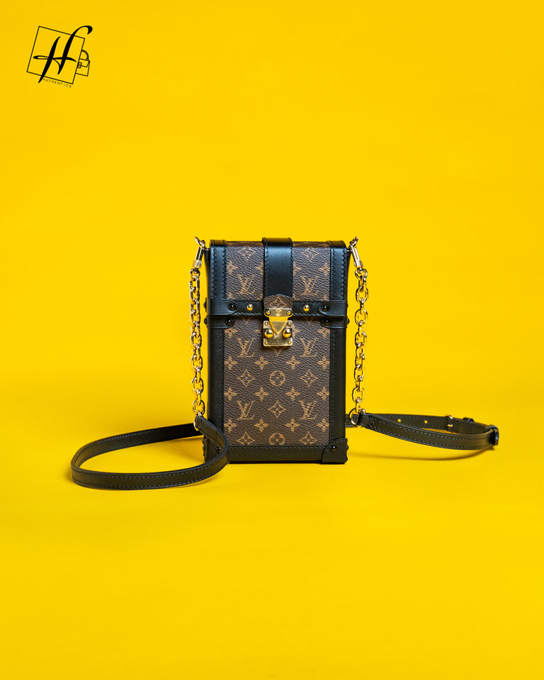 Louis Vuitton VERTICAL TRUNK POCHETTE