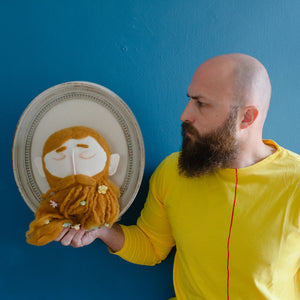 Brown beard head wall decor