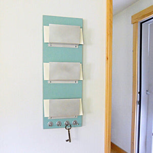 Mail holder mounted in the living room wall.