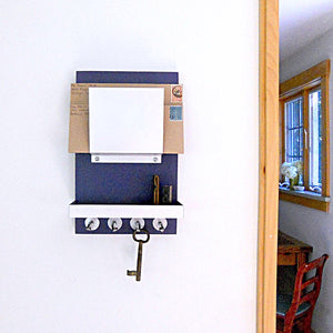 Navy blue mail holder mounted on the wall.