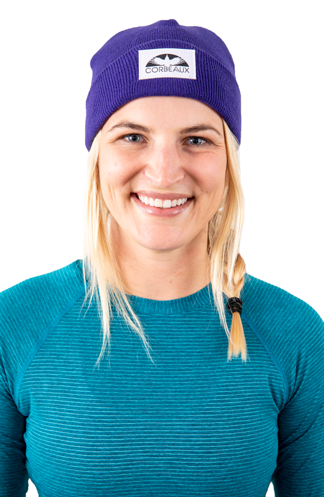Female model wearing the Wharf Beanie in color Barney purple