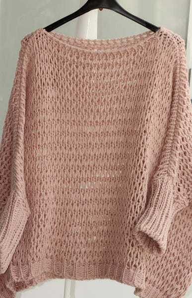 This oversized open weave sweater is perfect for layering with jeans or leggings. Available in Black, Camel and Soft Pink