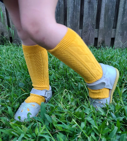 Mustard Cable knit knee highs