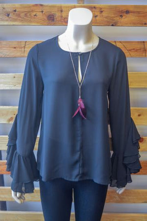 Black Ruffle Shirt and Feather Necklace