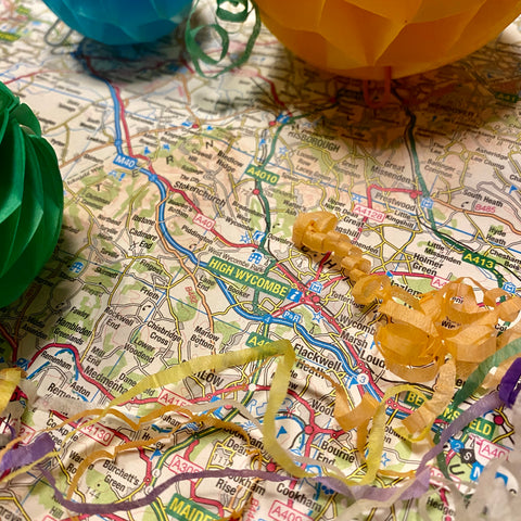 Ordnance Survey Map of High Wycombe surrounded by party poppers and decorations