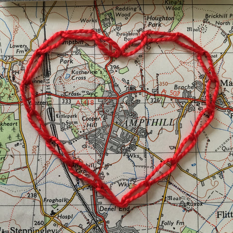 A vintage map of Ampthill hand embroidered with a heart