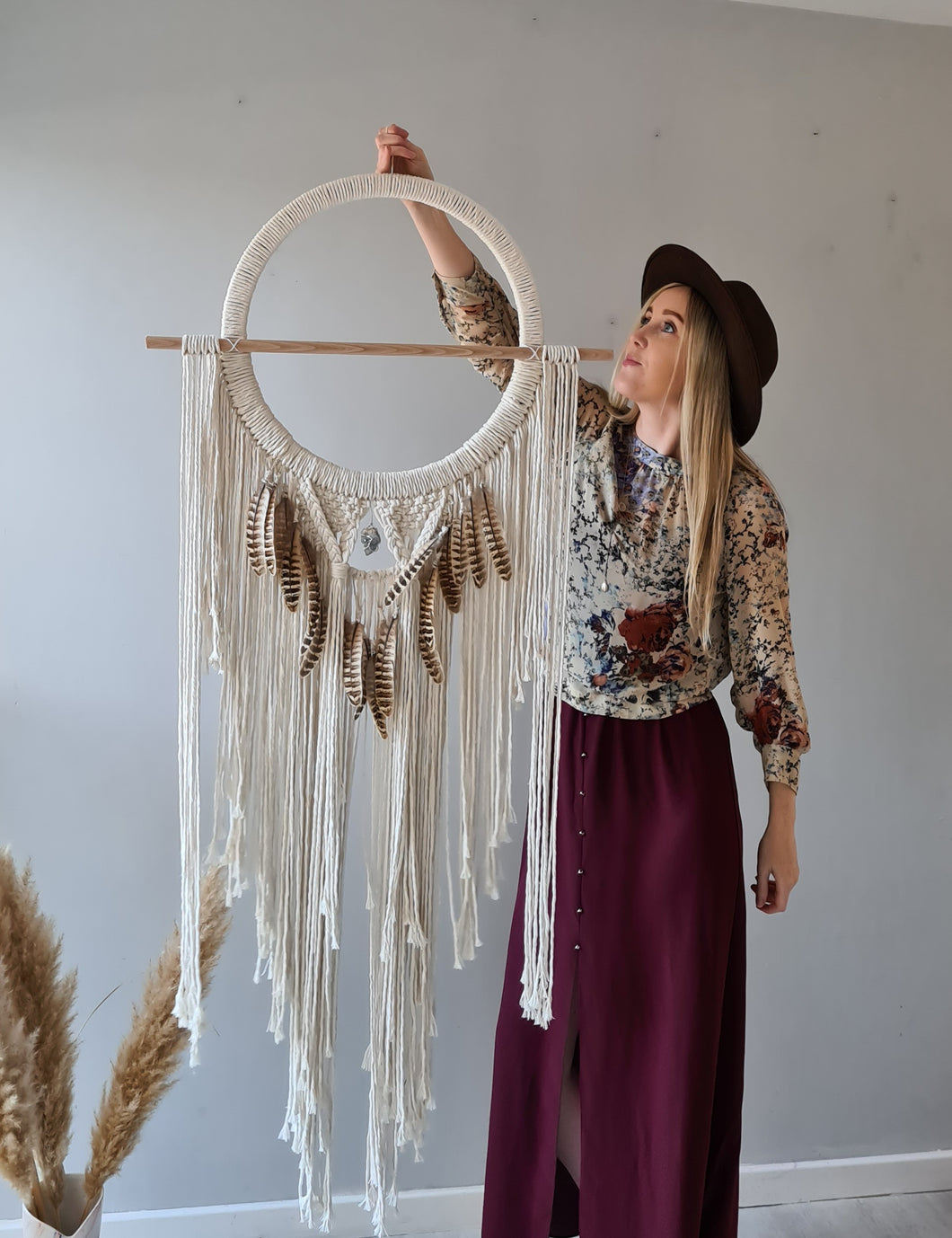 Feathered dreamcatcher with celestite stone.