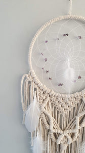 Romantic dream catcher with beautiful feather and bead detailing