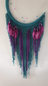 Peacock coloured moon catcher with pretty feathers