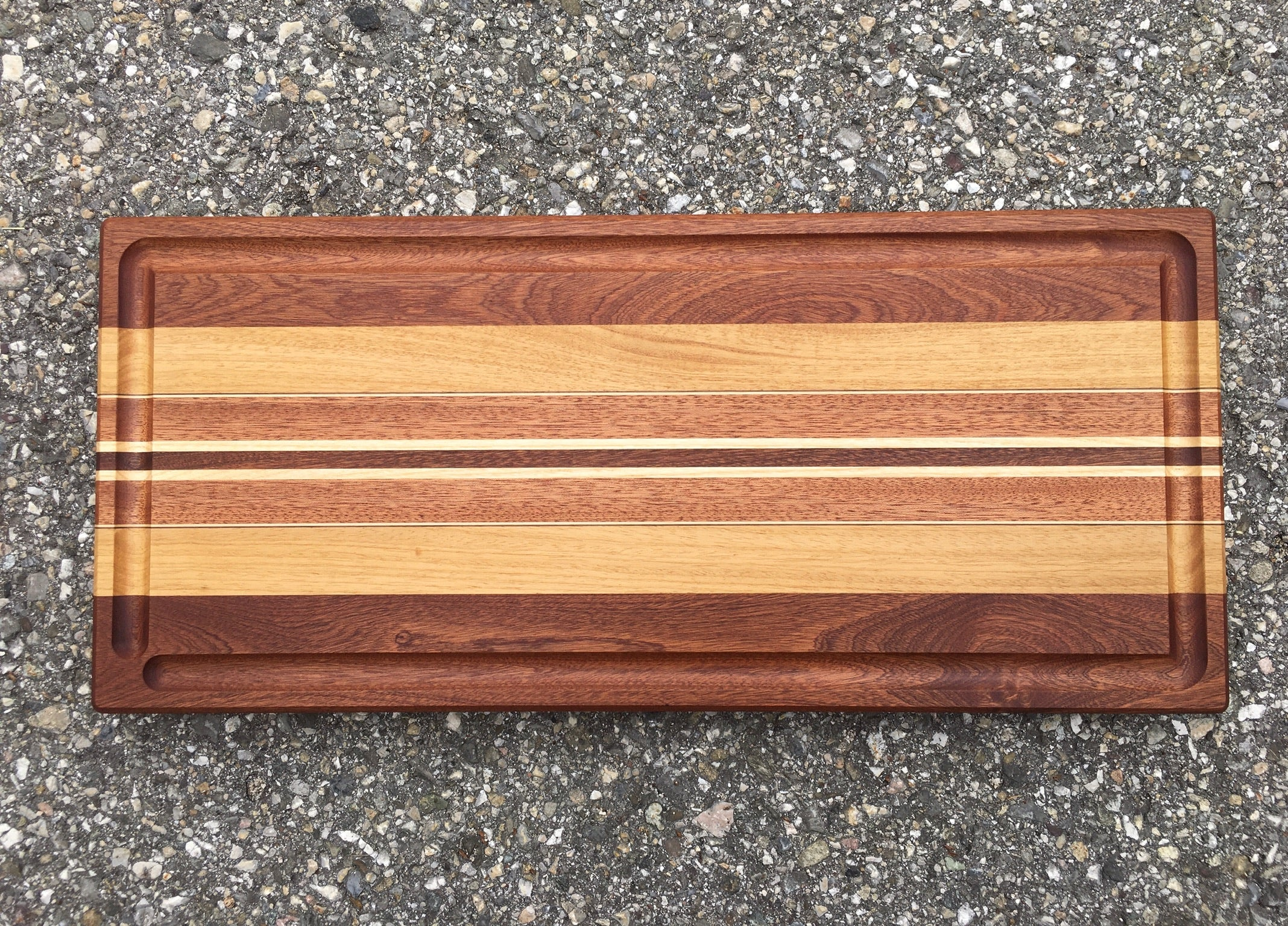 Multicolored Chopping board with linear marquetery.  Directly inspired by our Longboard.