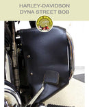 Black vinyl engine guard chaps on Dyna Street Bob OEM bar