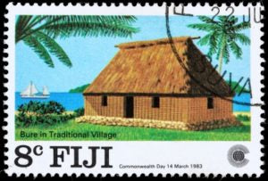 Fiji Bure in traditional village postage stamp