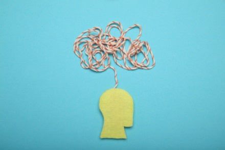 Illustration of human head showing anxiety by a piece of string being scattered everywhere above the head