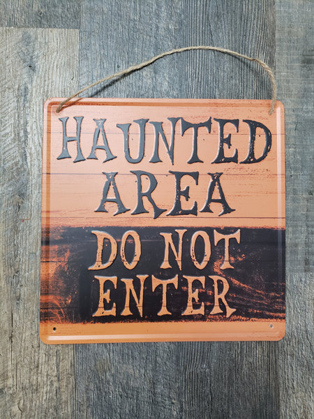 Haunted area metal sign