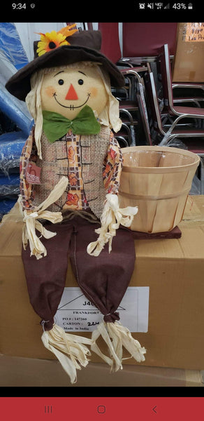 Scarecrow with basket shirt colors vary