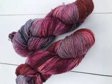 Load image into Gallery viewer, Trapeze Artist - Hand Dyed Fingering - SW Single 100% Merino in Maroons and Purples - knitting and crochet yarn
