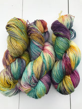 Load image into Gallery viewer, Shits and Giggles - Hand Dyed Fingering - SW 3 PLY 80/20 Merino and Nylon Blue, Magenta, Yellow and Purple - knitting and crochet yarn