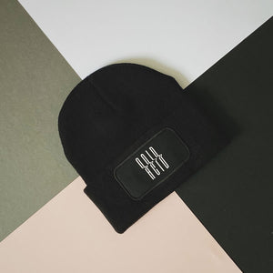 Streetwear styled black and white beanie hat | The Groovehouse