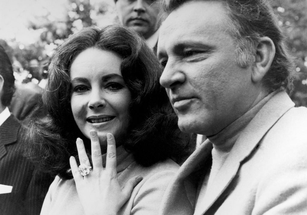 Elizabeth Taylor and Richard Burton. Here, Taylor proudly displays the incredible 33.19-carat diamond ring he gifted to her.