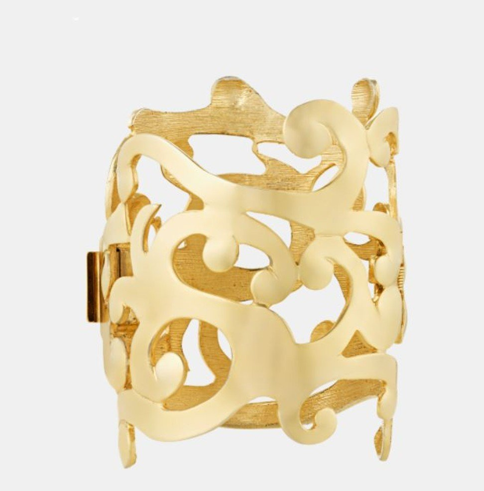 A seven-inch-wide gold cuff in a floral pattern, by Ugo Correani for Versace, and owned by Prince, is priced at US$12,850. Photo: Handout
