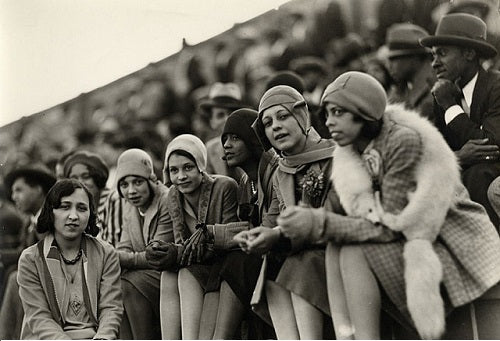 A group of young African-American flappers taking in a football game.
