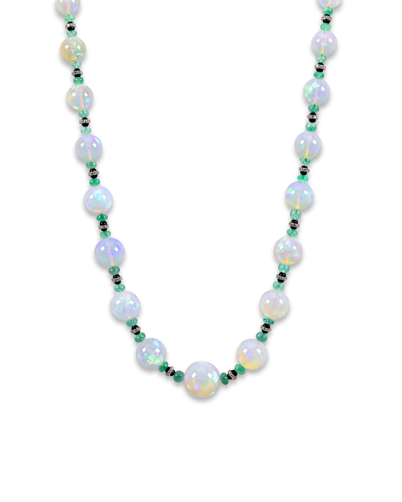 This necklace features thirty-one opal beads weighing approximately 493.0 total carats. These beads display incredible translucence and a stunning range of color