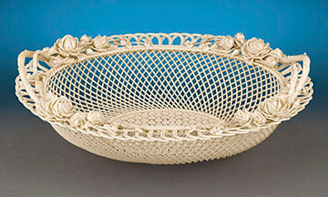 This exceptional Belleek porcelain two-handled basket is an outstanding example of the delicate artistry for which this Irish company is known