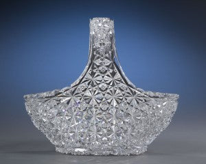 Complex, intricate cuts cover the entire surface of this stunning cut glass basket featuring the exotic Persian variation of the Russian pattern.