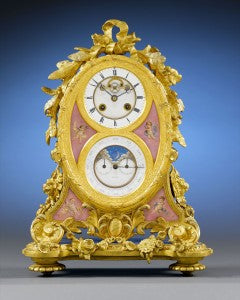 Scottish jewelry firm Muirhead & Son crafted this fine ormolu and porcelain mantel clock