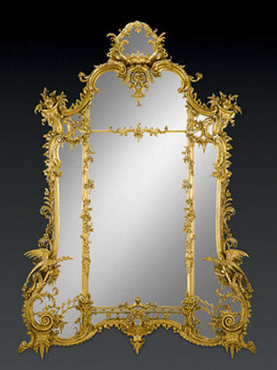Commanding in proportion and size, this stunning giltwood mirror is of exceptional quality, styled after the innovative Rococo designs of the legendary English cabinetmaker Thomas Chippendale