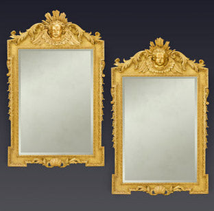 A significant and stately pair of George II period giltwood mirrors of superb condition and quality