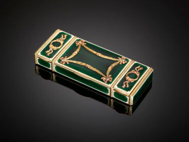 "A gold and enamel vanity case that epitmozes Fabergé's business model to create ""objects of fantaisie"", objects with both an artistic and functional value."