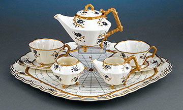 This delightful and rare Belleek dejeuner tea set exhibits the intriguing Thorn pattern