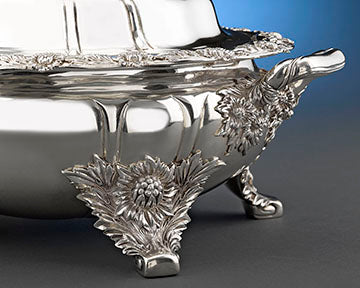 """Close up of the Tiffany & Co. """"Chrysanthemum"""" Silver Entree Dish. The firm is renowned for the depth and intricacy of their silversmithing"""