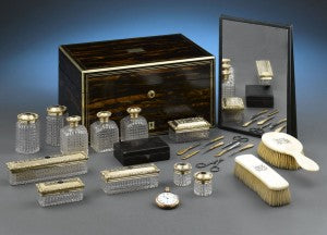 Gold gilded silver and cut crystal accentuate the various toiletries inside