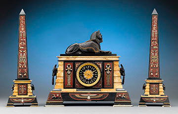 This amazing Egyptian Revival clock garniture by J. E. Caldwell & Co. of Philadelphia is almost identical to the set that is housed in the collection of the Metropolitan Museum of Art