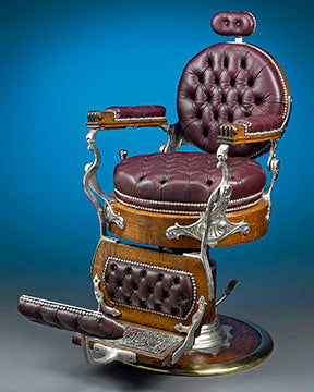 A handsome oak and nickel-plated hydraulic barber chair manufactured by Theodore A. Kochs of Chicago.