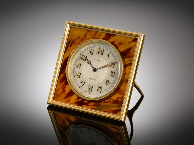Crafted of luxurious tortoiseshell, this sleek desk clock by J.E. Caldwell & Co. exudes Art Deco elegance.