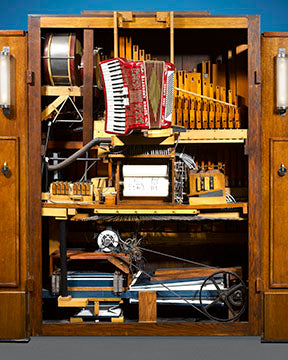 This mechanical marvel is essentially an entire band set within an elegantly constructed Art Deco cabinet