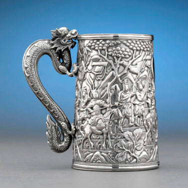 Large Chinese Export Silver Beer Tankard: This mid-19th century silver tankard made by Lee Ching of Canton, Shanghai and Hong Kong was made specifically for export, with a wealthy Western buyer in mind. The high-quality repoussé work reveals an exciting battle scene, while the handle's vibrant dragon sculpture evokes Chinese symbolism of good luck and strength. Price: $9,850