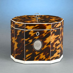 This beautiful George III tea caddy is enveloped in elegant tortoiseshell. Caddies of rare tortoiseshell are especially prized, for they are among the scarcest and most luxurious examples produced.