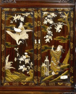 Exquisite Shibayama inlay of bronze, ivory and mother-of-pearl inform the entire piece