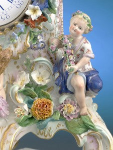 The babes are nestled within elaborate Rococo decoration bearing items representative of each season